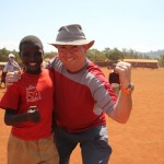 Edward Prutschi is wearing a Tissot Sea Touch on a trip to Ayalabe Primary School in rural Tanzania near Karatu, where his kids got to meet their pen pals and donated supplies to the school.