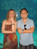 ay and Janna Jarmin celebrating their first wedding anniversary at the Atlantis Aquarium in the Bahamas. Jay is wearing a Tag Heuer Monaco, Steve McQueen CW2113 with a black Python strap. Janna is wearing a Tag Heuer Aquaracer 500 m Rose Gold Calibre 5 Watch.