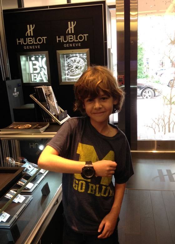 Benjamin Krut tries on a Hublot Oceanographic 4000 731.QX.1140.RX at the Hublot Boutique in Boca Raton, Florida, while on a father-son watch shopping expedition.