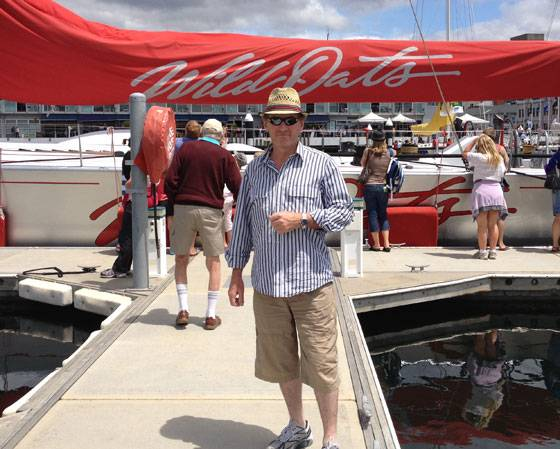 Chris McGregor wears his Two Tone Blue face Rolex Submariner 2011 standing in front of WIld Oats, the winning yacht of the Rolex Sydney Hobart Yacht Race.