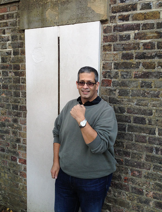 Raffi Jehanian, wearing his Swiss Army Officers Watch on vacation in England at the GMT line in Greenwich, England.