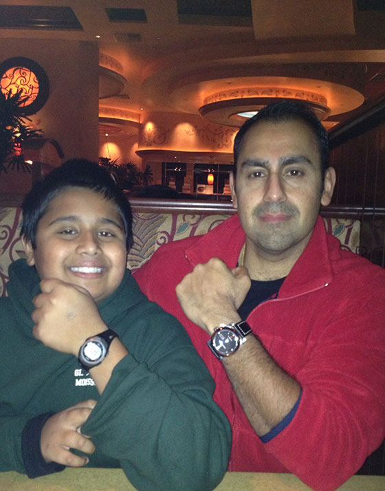 Ravi Sehti and his son Sid Sehti (a young WatchTime reader) show off their watches while celebrating a birthday at a restaurant in Folsom, CA. Sid is wearing his first watch, a Casio digital watch, and Ravi is wearing a custom Enzo Mechana Reference 500 with domed crystal and Omega ETA automatic movement.