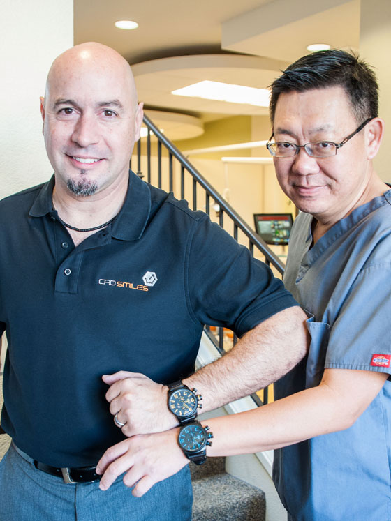 Dr. Yao-Lin Tang (right) and Eddie Corrales, both wearing a limited edition Elegantsis.