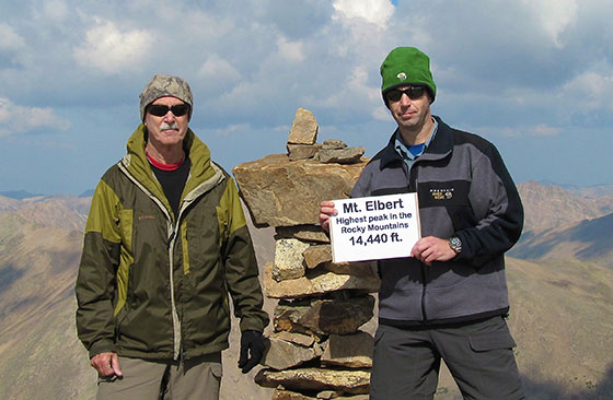 "Kevin Willey, wearing a titanium Omega Speedmaster ""Solar Impulse"" HB-SIA Co-axial GMT Chronograph, and his father Larry standing on the summit of Mt. Elbert in the Colorado Rockies, at an elevation of 14,440 feet, the highest point in the state of Colorado, the highest peak in the Rocky Mountains and the state of Colorado, as well as the second highest point in the continental U.S."