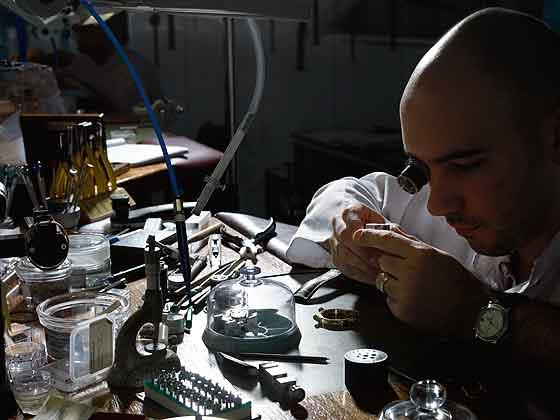 Cartier watchmaker assembles movement