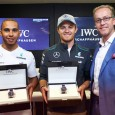 Lewis Hamilton and Nico Rosberg with their IWC Big Pilots Watch handed over by Goris Verburg, Director Marketing & Communication at IWC