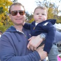Jeff Ackerman and 10-month-old son Spencer at the local farmers market in Birmingham, Mi.  Jeff is wearing his new Panerai PAM 425 SLC Radiomir.