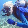 Jean Michel Cousteau diving with Doxa watch