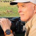 Mark Alberhasky wears his Omega Speedmaster Solar Impulse HB-SIA while photographing cheetahs in Kenya's Masai Mara.