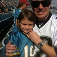 Josh Putterman, wearing his Rolex Submariner anniversary edition with green bezel, and his daughter Grace at a Jacksonville Jaguars football game in Jacksonville, FL.