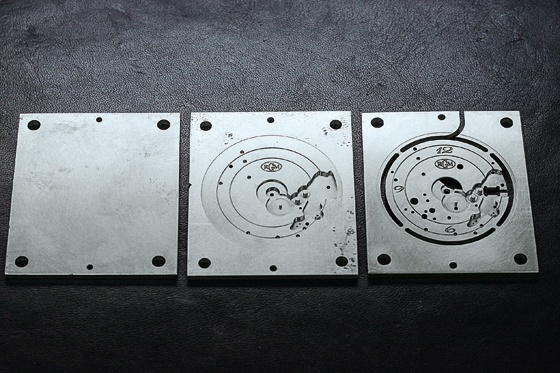 The movement's plate and bridges are cut from playing-card-size pieces of nickel silver.